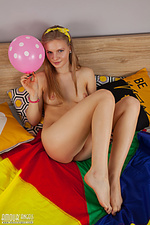 Blonde teen playing alone