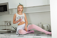 Naked teen in the kitchen